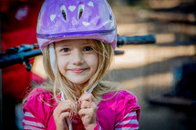 girl child wearing a bike helmet
