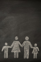 A chalkboard drawing of a family holding hands.