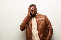 an African American man with a headache