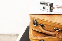 camera on stacked luggage