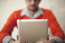 Adult man looking at an iPad