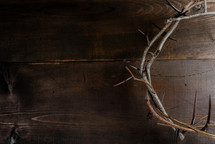 crown of thorns on a wooden background