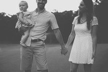 father, daughter, mother, outdoors, holding hands, love, parenting, young family, family, happy