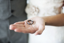 bride holding rings in her hand