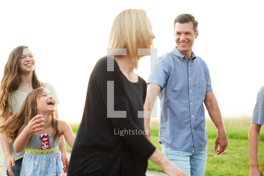 a family walking down a rural road spending time together at sunset