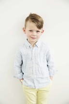 portrait of a young boy in church clothes