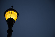 view of lit lamppost from below