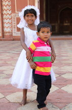 two children in India at first communion