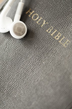 Ear buds on a Bible.