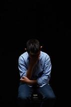 a boy feeling guilty