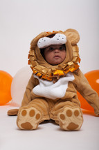 a toddler boy in a lion Halloween costume