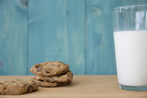 cookies and milk on a wood table.