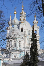 Smolny cathedral domes and steeples with gold crosses