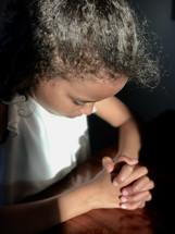 sunlight on praying hands