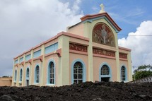 Notre Dame Des Laves Church, surrounded by volcanic lava.
