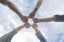 circle of touching fists
