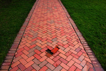 misplaced brick on a path