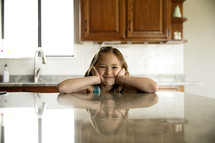a little girl in a kitchen
