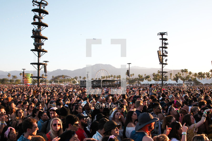 large crowd at an outdoor festival