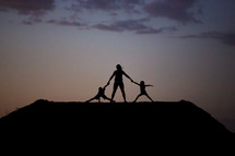 silhouettes of children at sunset
