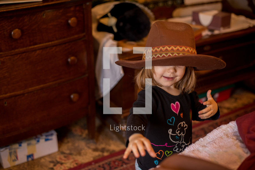 toddler girl in a cowboy hat