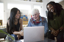 women looking at a computer screen