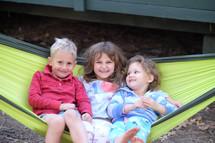 siblings in a hammock