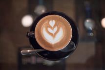 design in creamer in coffee