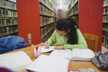 college girl studying in a library