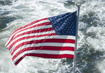 American flag on a boat over water