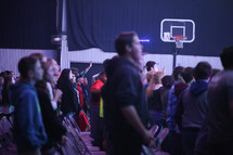 youth at a worship service in a gymnasium