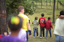 kids walking through a forest