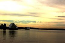 house on the shore across a lake