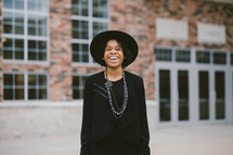 An African American woman in a black hat