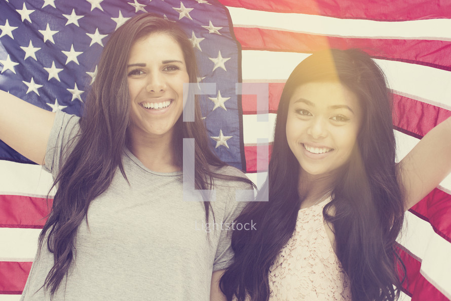 friendship between young women under an American Flag