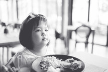 toddler girl eating dinner