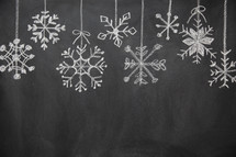 snowflake border on a chalkboard