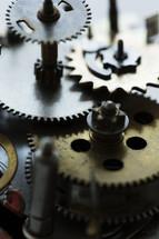 macro photo of gears in a clock.