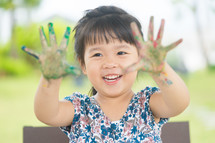 girl with paint on her hands