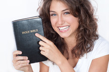 woman holding a Bible