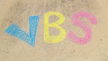 VBS title in sidewalk chalk