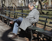A man sitting on a park bench
