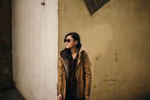 model posing in sunglasses