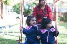 girls swinging on a swing