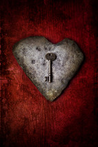 "skeleton key on stone heart - concept for the saying ""the key to my heart"""