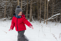 a child playing in the snow