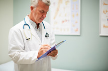 a doctor holding a clipboard