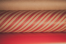 Close up of three rolls of Christmas wrapping paper