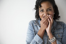 an African American woman giggling