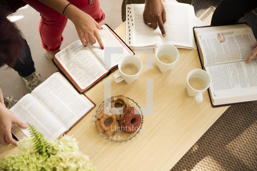 woman's group Bible study reading and discussing scripture on a porch